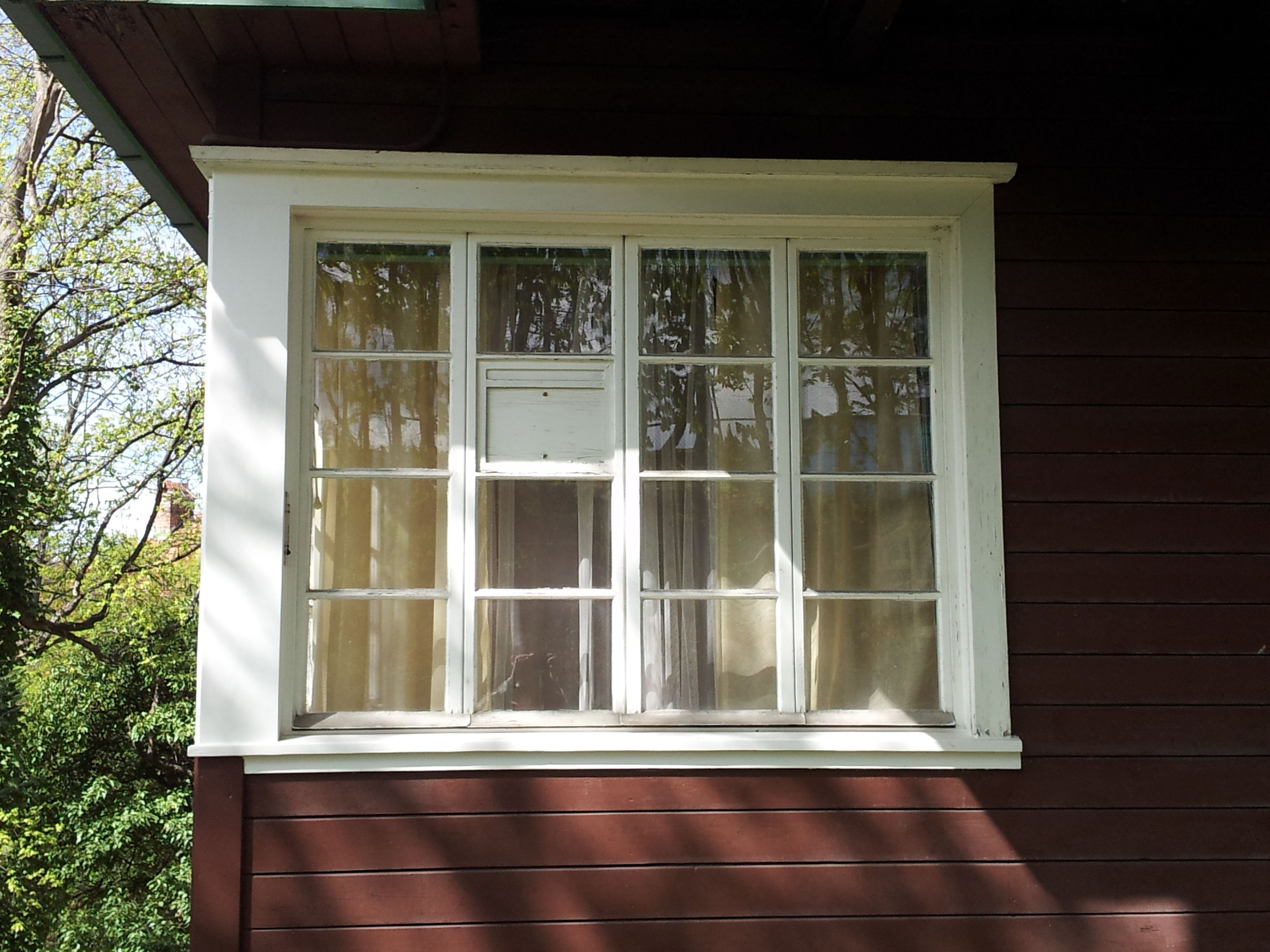 How to clean house windows - Window In Living House With 16 Separated Glass Elements And Clean White Frames