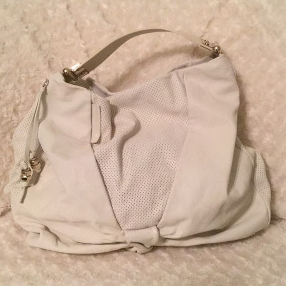 Marc by Marc Jacobs Hobo Bag Authentic white leather with perforated leather detailed with silver  hard wear. Iconic Marc Jacobs cotton heart in sole. Marc by Marc Jacobs Bags Hobos