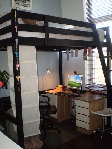 Like the idea to hang a sweater organizer under lofted bed