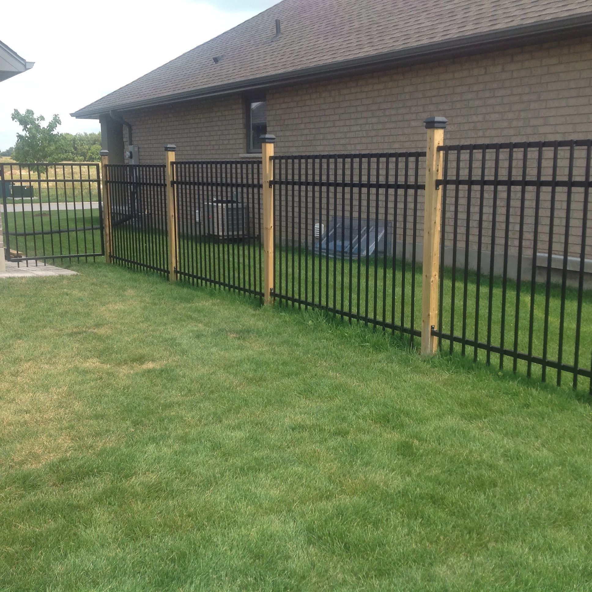 Wrought Iron Fence With 4x4 Wood Posts Black Caps Iron Fence Wrought Iron Fences Aluminum Fence