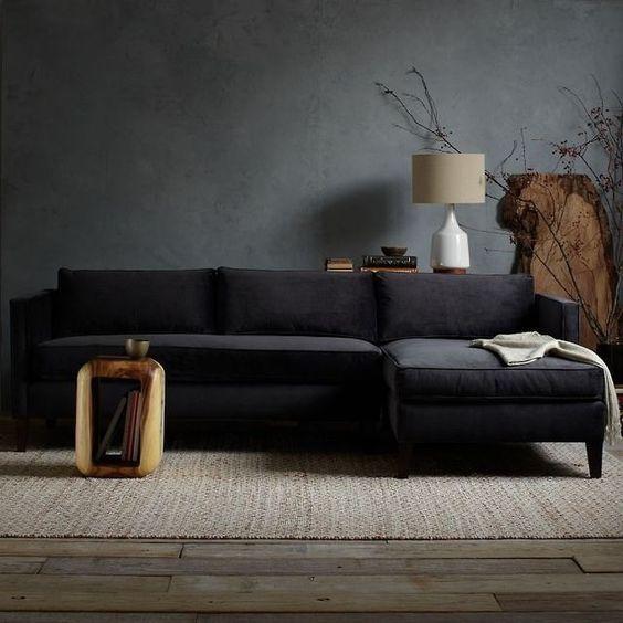 Dark Grey Walls A Black Sofa And Raw Wood Furniture For A Natural Feel Dark Living Rooms Moody Living Room Living Room Paint