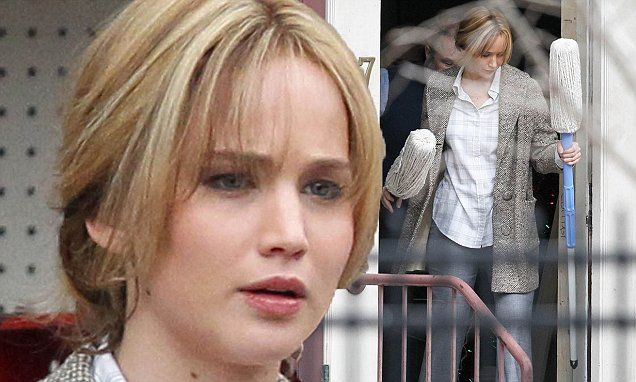 Jennifer Lawrence carries a couple of mops on Joy set in Massachusetts