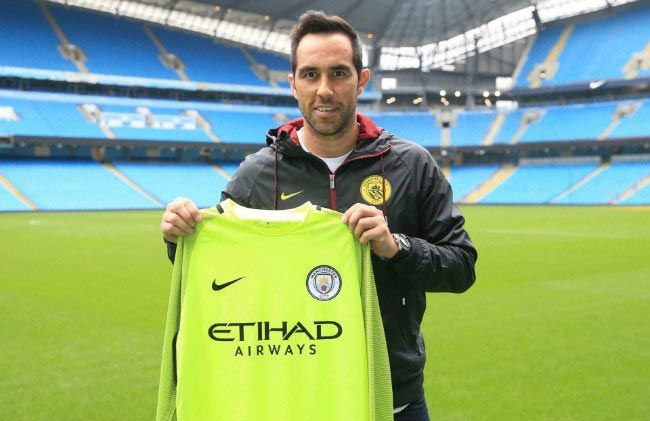 2be52a63796 Claudio Bravo poses with the Manchester City jersey at his official  unveiling at the English club on August 24