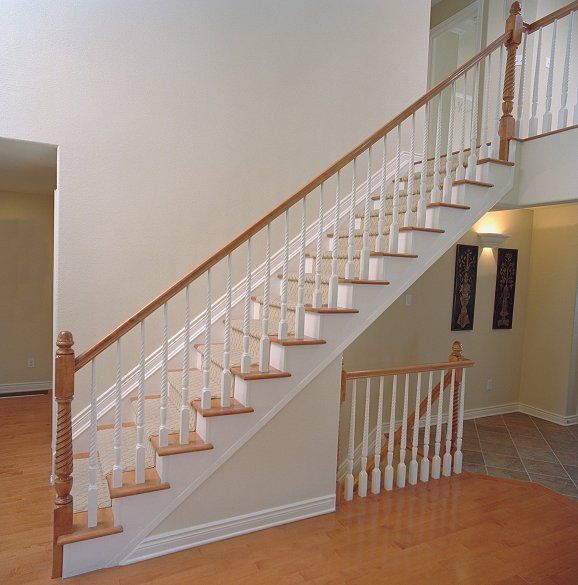 Straight Staircase. No Bullnose. Newel Post Is Cut Around The Step. White  Risers