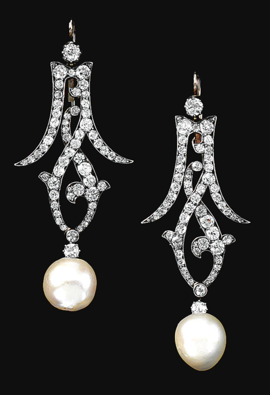 PAIR OF PEARL AND DIAMOND EAR PENDANTS, LATE 19TH CENTURY.  The open work surmount of entrelac design set with circular-cut diamonds, one supporting a natural pearl, the other now supporting a cultured pearl, the cultured pearl is a later replacement.