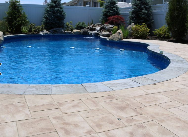This beautiful new york pool patio was created by design - Albardilla piscina ...