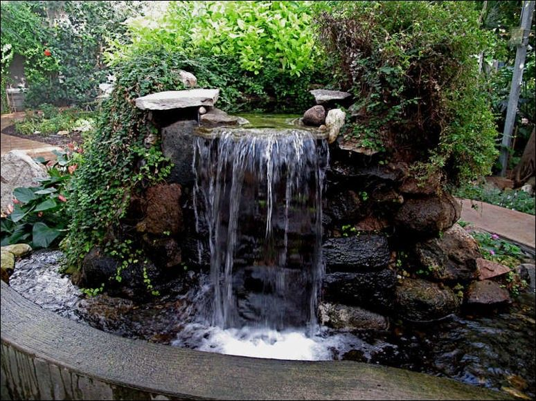 Build a waterfall fountain next to the dining space for a relaxing  ambiance. Description from