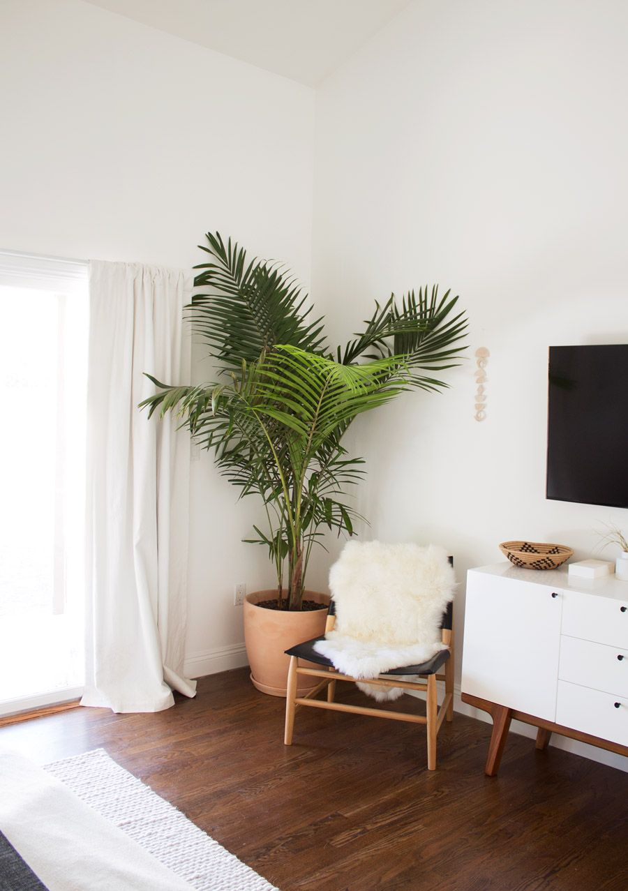 living room plant decor square tables take a tour of this minimal boho bedroom on the west elm blog