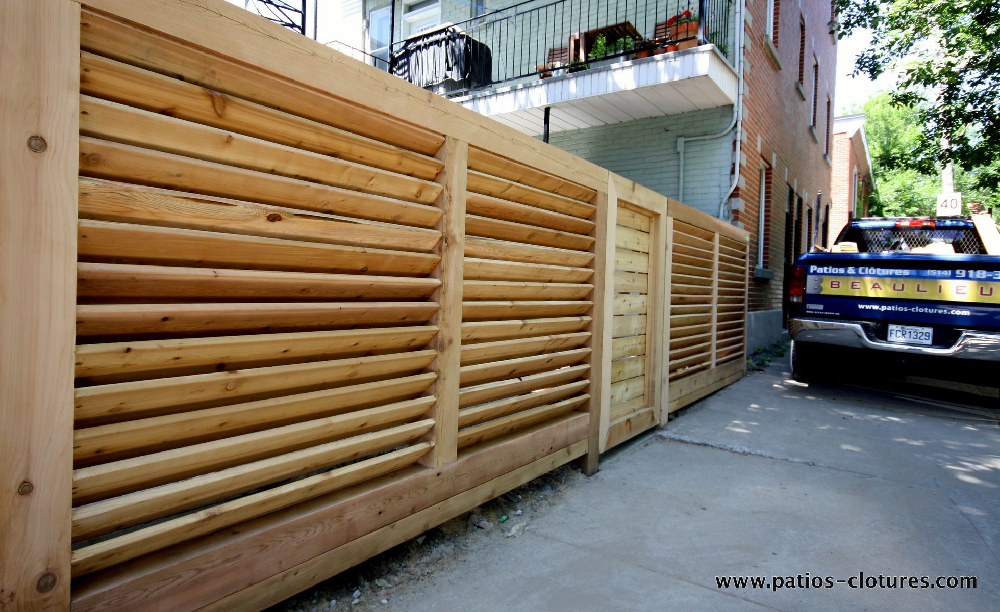 robust horizontal louvered fence. the posts, the top and bottom