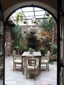 Archway To Glassed Covered Interior Courtyard Amp Fountain