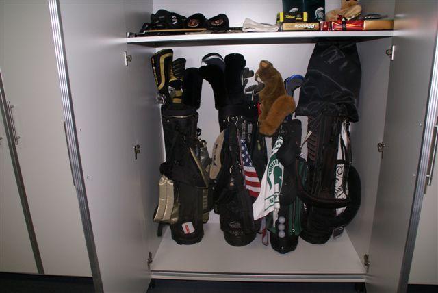 The perfect place to store golf clubs! #garage #storage. www.closetorganizersdc.com 1-800-293-3744