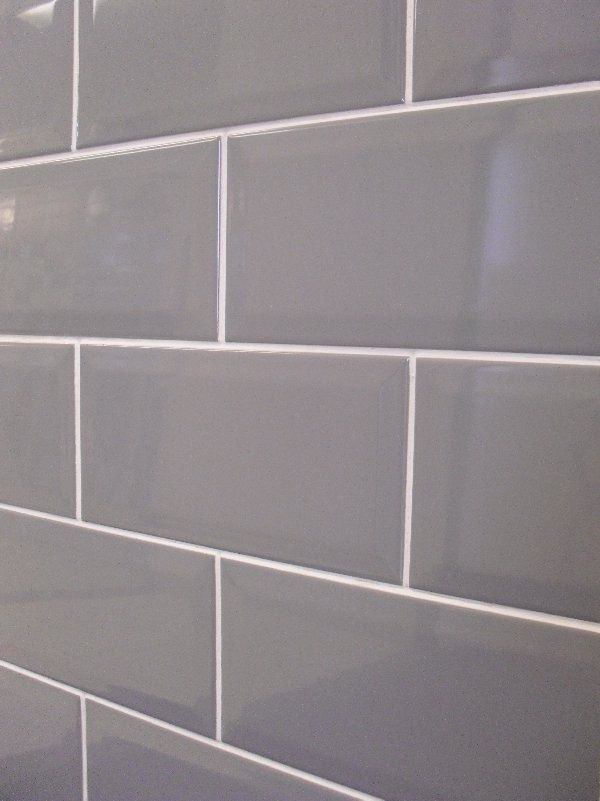 grey subway tile with white grout for behind stainless hood.   My Style Decor