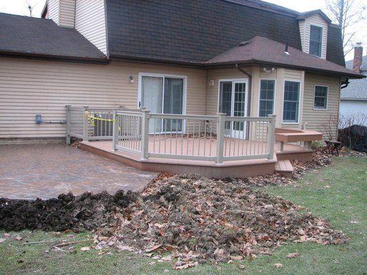 Trex and cement deck composite decking vinyl rails and for Concrete patio railing