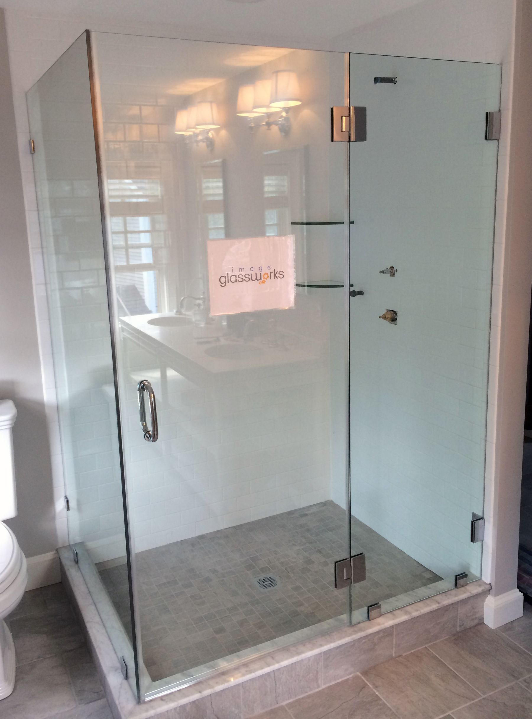 A Frameless Swinging Shower Door Hinged From The Stationary Panel Which Closes Against A Large Return Glass Shower Door Hinge Shower Doors Swinging Shower Door