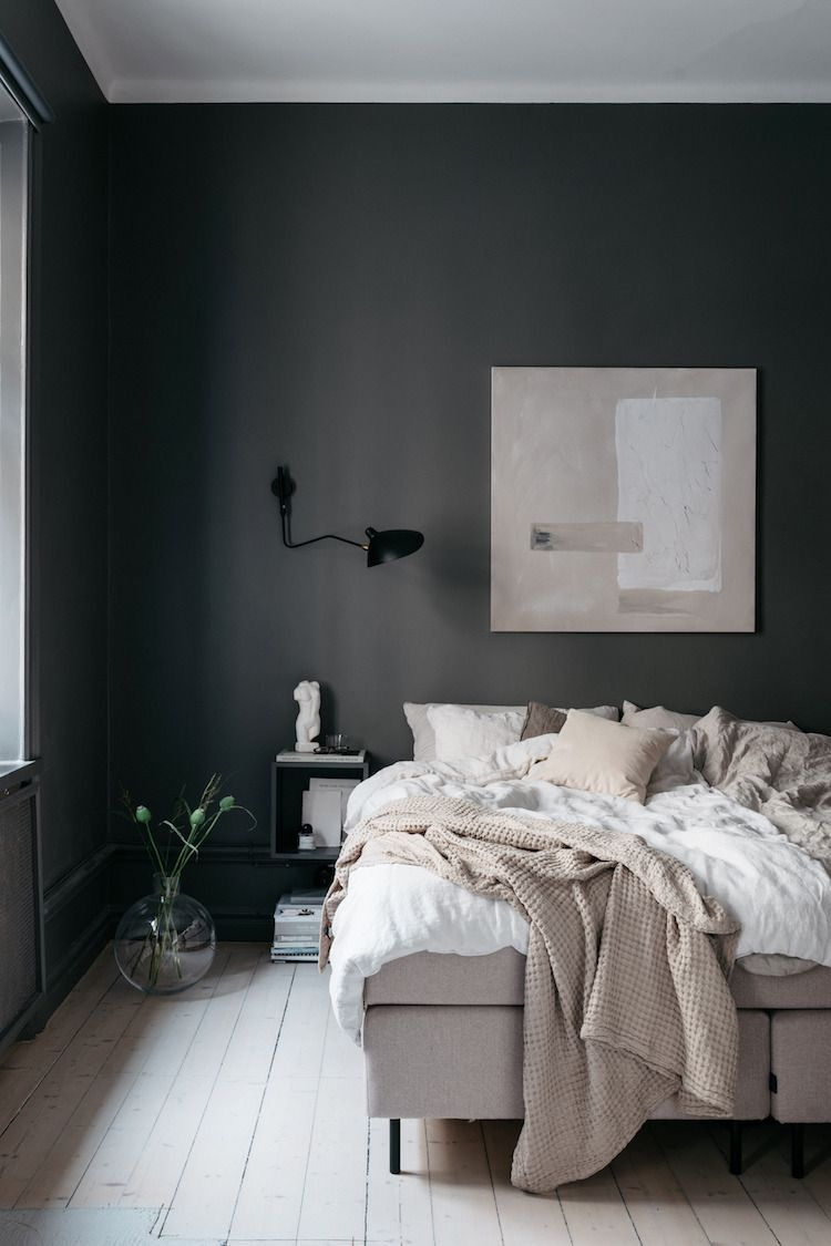 Scandinavian Bedroom Dark Grey Walls Textiles In Soft Beige Hues Wall Art And Wooden Floors Stylish Bedroom Decor Stylish Bedroom Bedroom Design