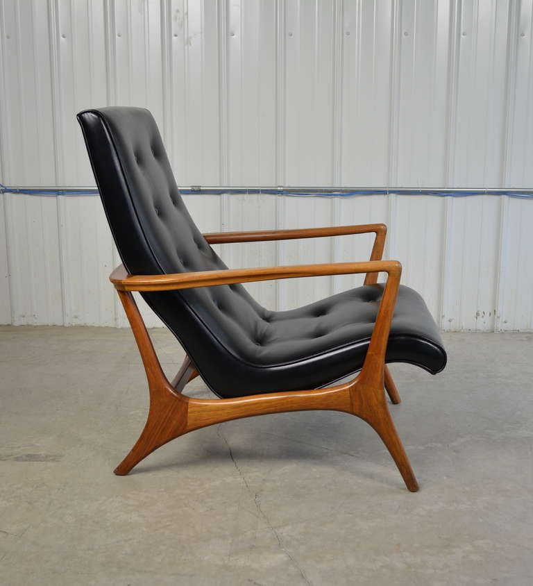 mid-century modern walnut and leather lounge chair | leather