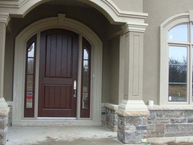 Front door with sidelights also love the stone and stucco - Average cost to paint exterior house trim ...