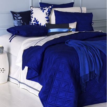 Bright Blue Walls Bring This Modern Bedroom To Life Blue Bedroom