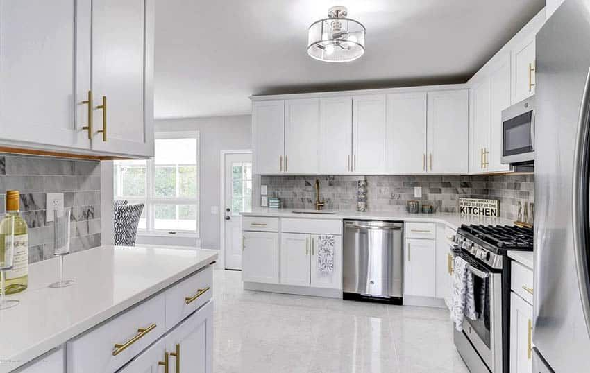 White Cabinet Kitchen With Marble Tile Floors And Marble Backsplash White Marble Kitchen Marble Floor Kitchen White Kitchen Tiles