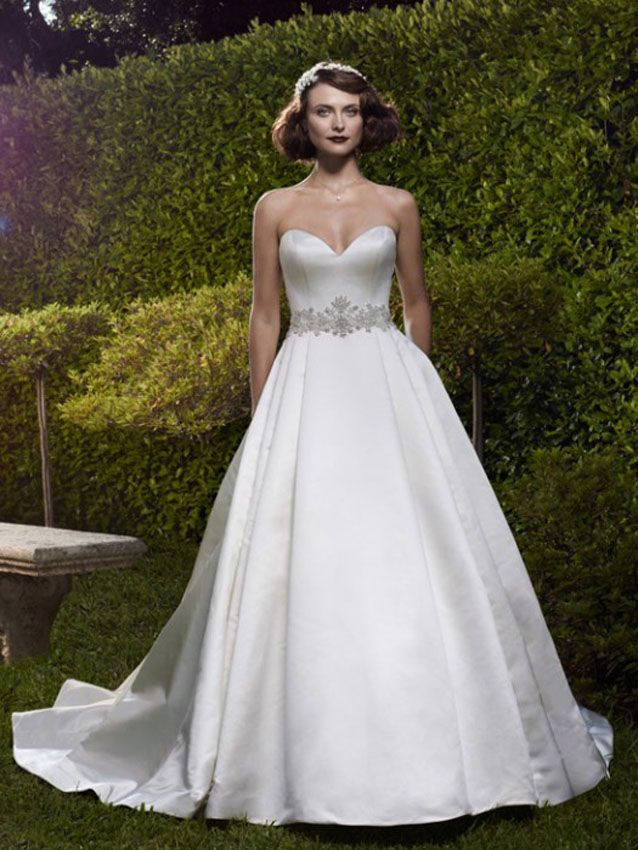 Seeing is believing and every feature you see in Casablanca Bridal 2073G wedding dress will make you a believer…the glorious sleek satin gown will take you from maiden to married lady in a sweetheart strapless gown that thas a distinct look of love and beauty! The snug fitting bodice meets the natural waistline and the embellishments at that point are stunning beaded appliques. As the skirt flows to the floor in a fluid-like movement, the side box pleats add fullness to the elegant gown.