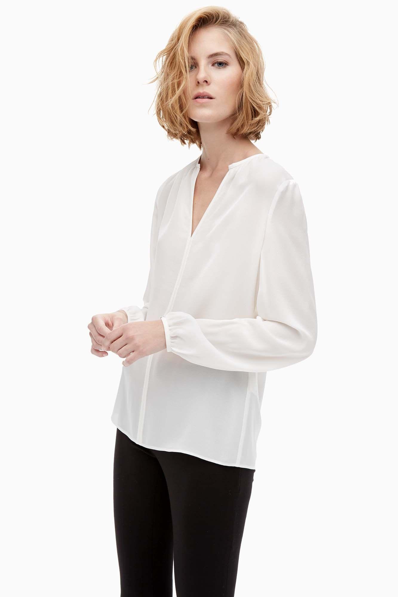 Camisa de seda con puños abullonados