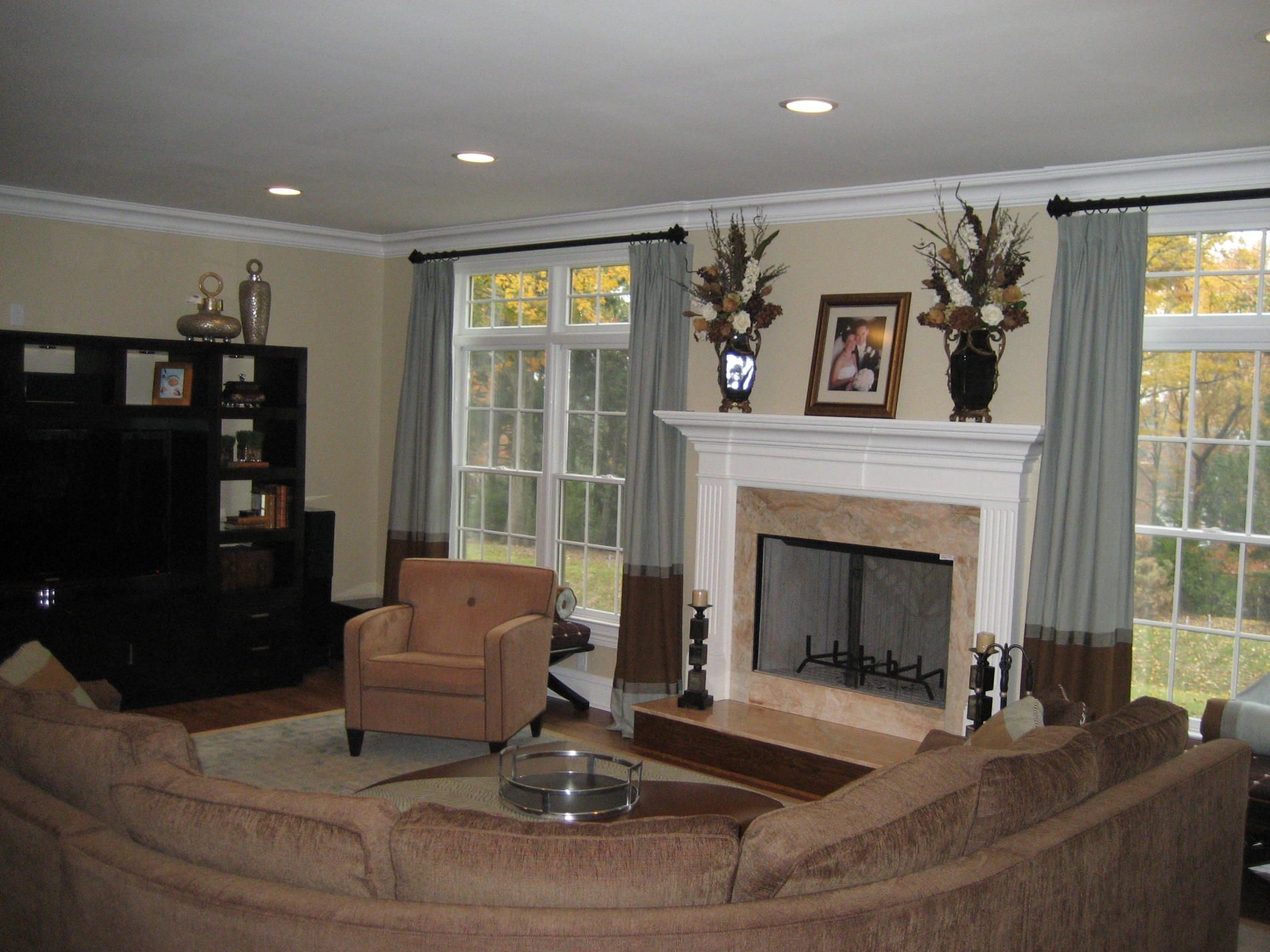 Living Room With Fireplace And Windows fireplace between two windows - google search | kitchen