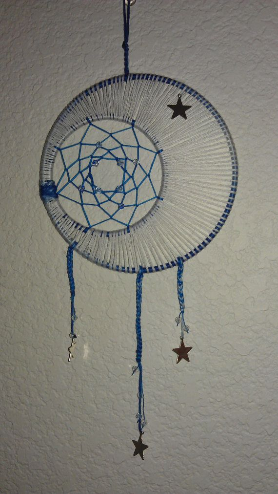 Hey, I found this really awesome Etsy listing at http://www.etsy.com/listing/152229779/blue-and-white-moon-dreamcatcher