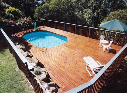 Spacious Deck With Pool At One End Above Ground Pool