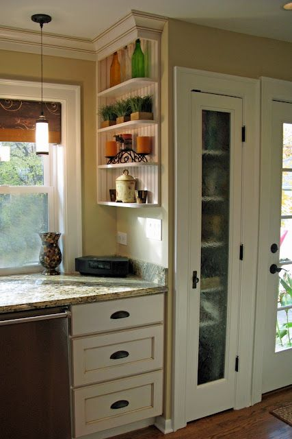 I like this style. I like the little shelf and the counter tops and the pantry door.