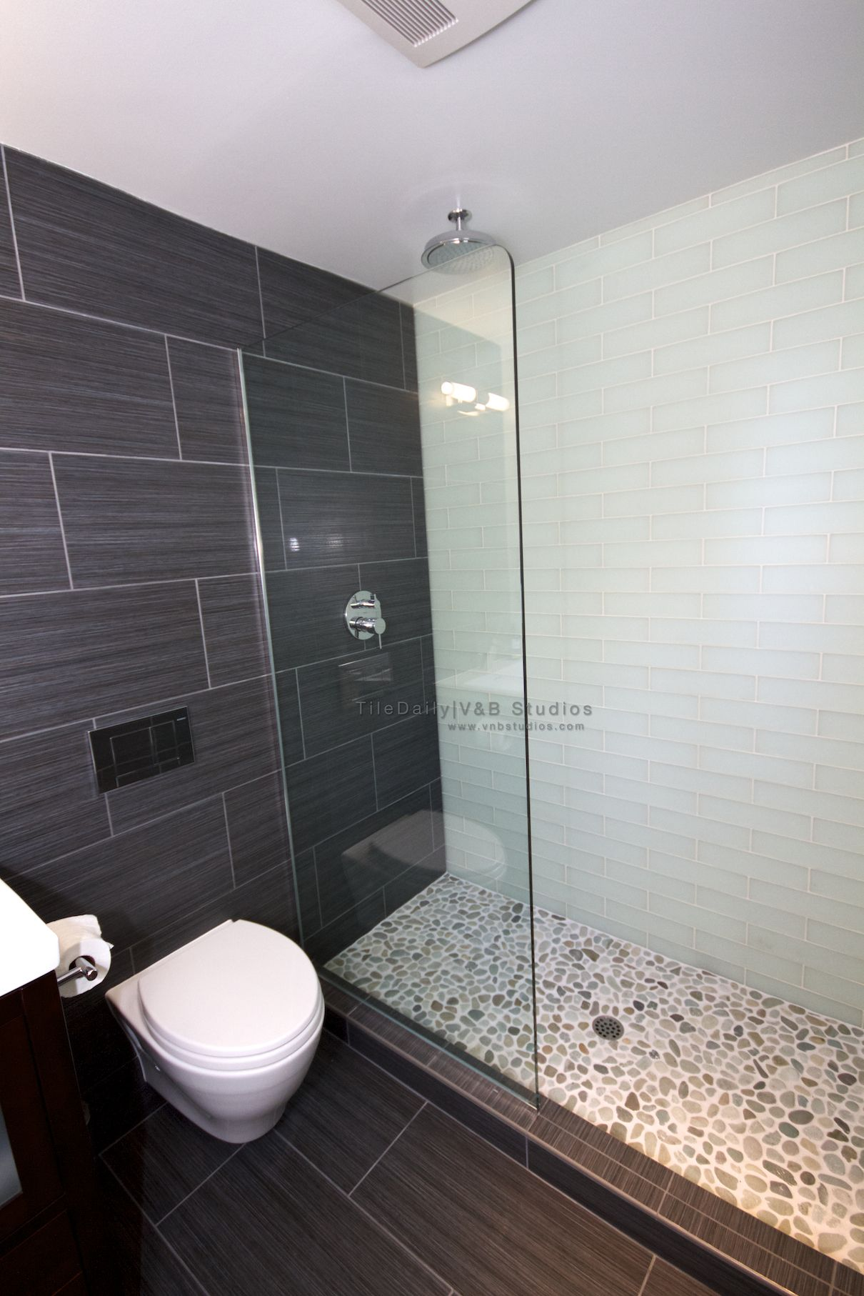 Grey and white shower with pebble look floor. So nice!!