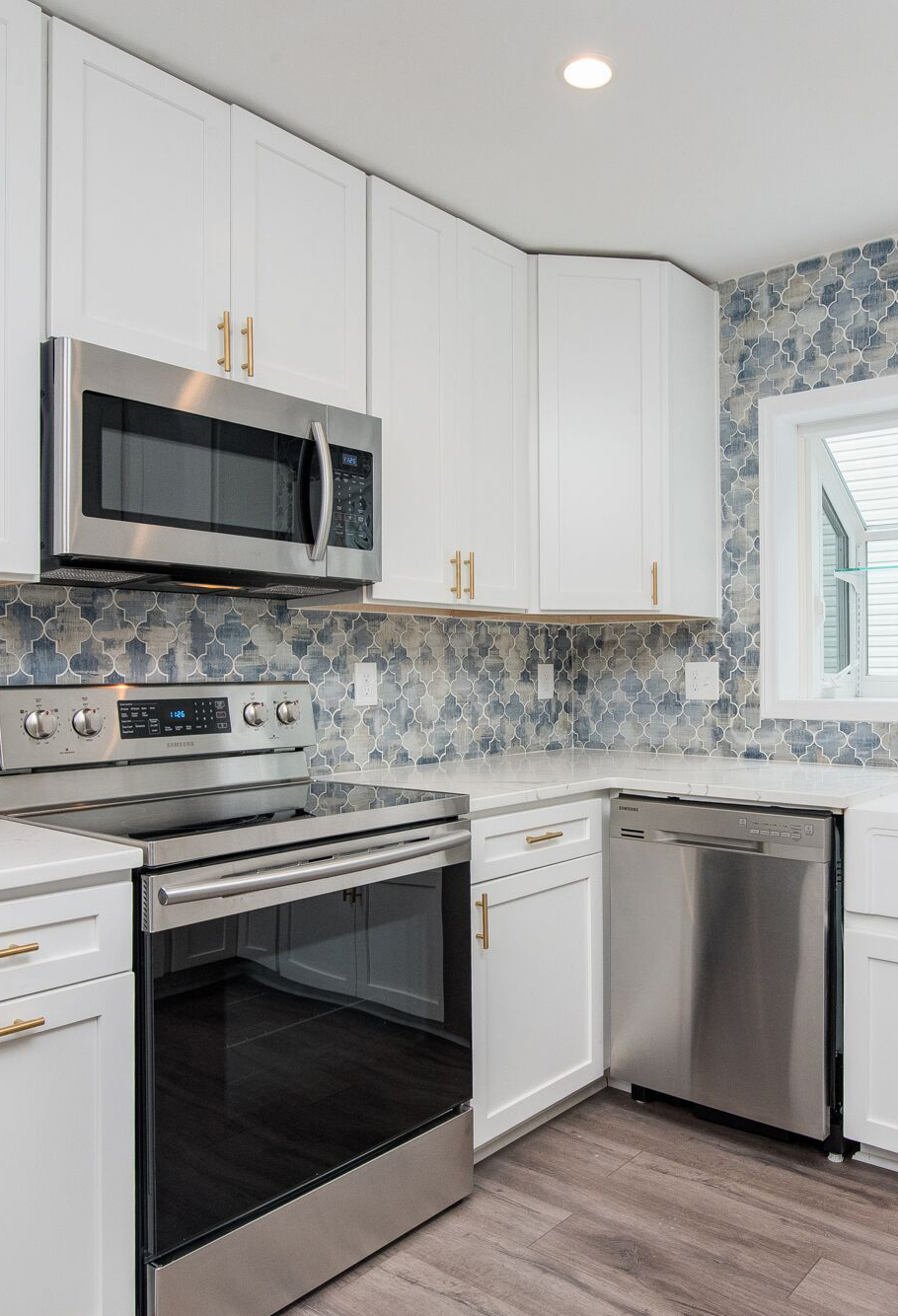 White Cabinets With Colorful Backsplash Online Kitchen Cabinets Cabinet Cabinets Online