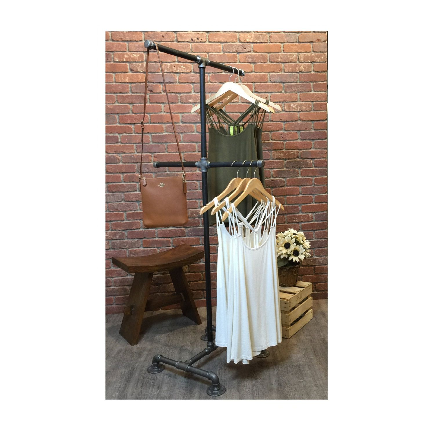 Industrial pipe clothing rack by william roberts vintage this pipe clothes rack is made using black pipe and pipe fittings this extremely durable and
