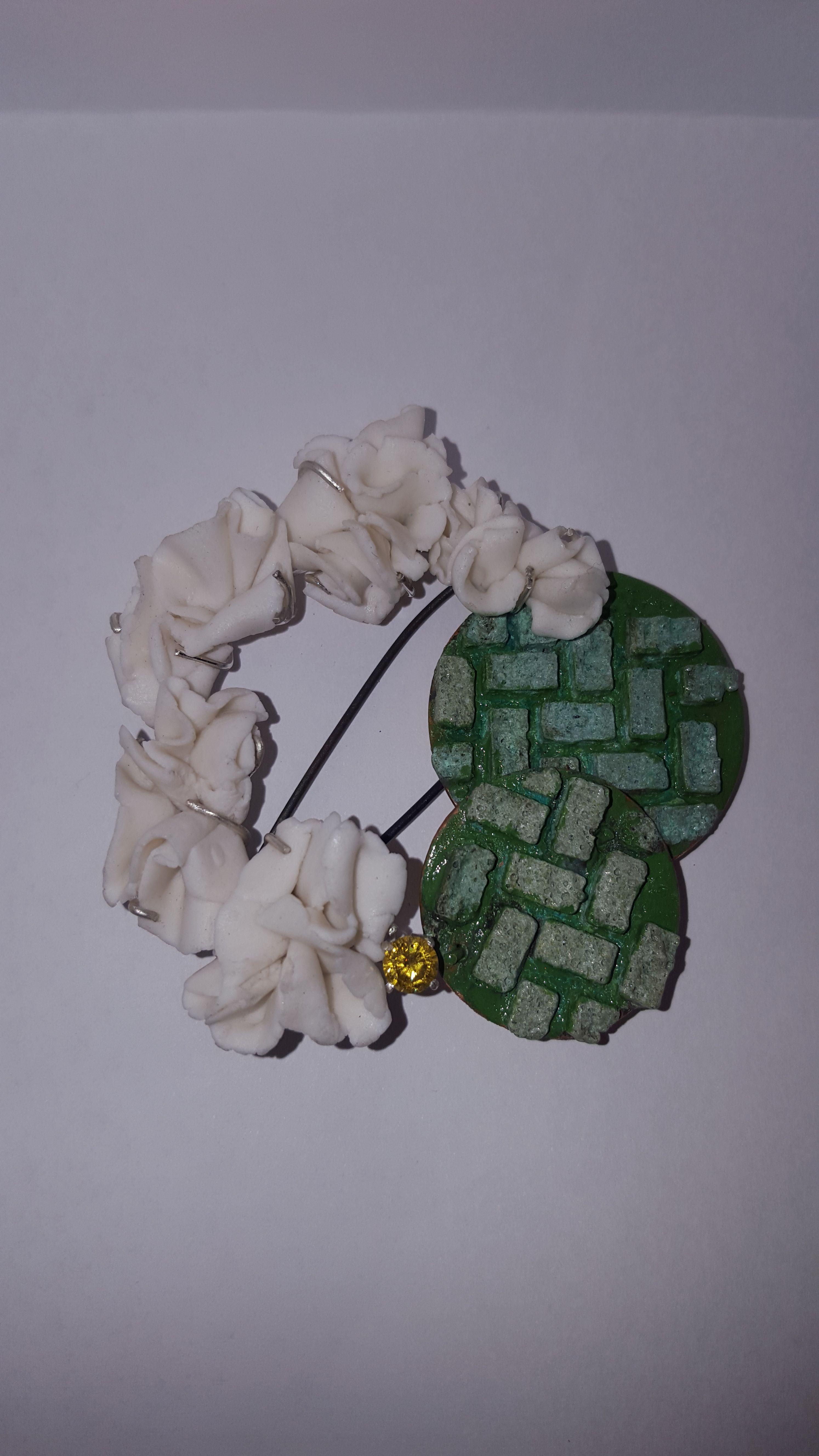 Anna Jasinska, Brooch with porceline pieces, enamelin and yellow zirconia