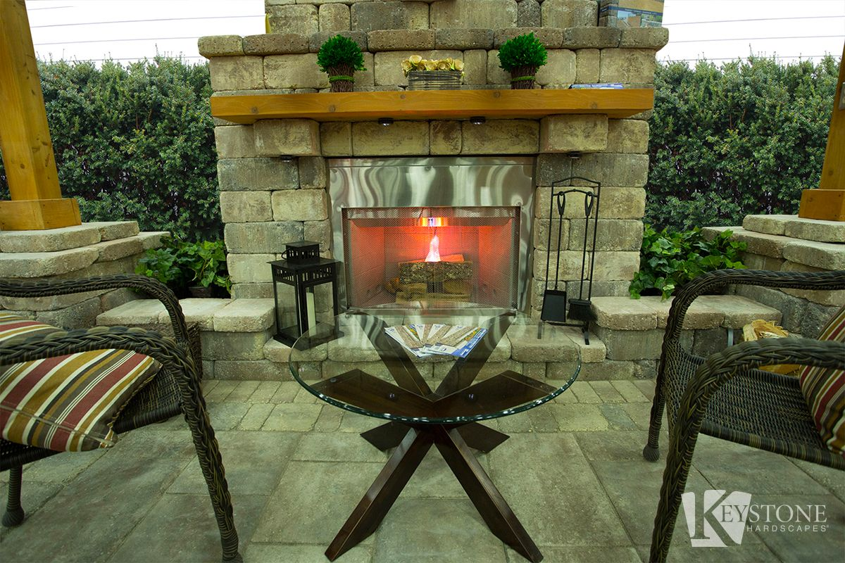 A cozy looking Stonegate Country Manor outdoor fireplace