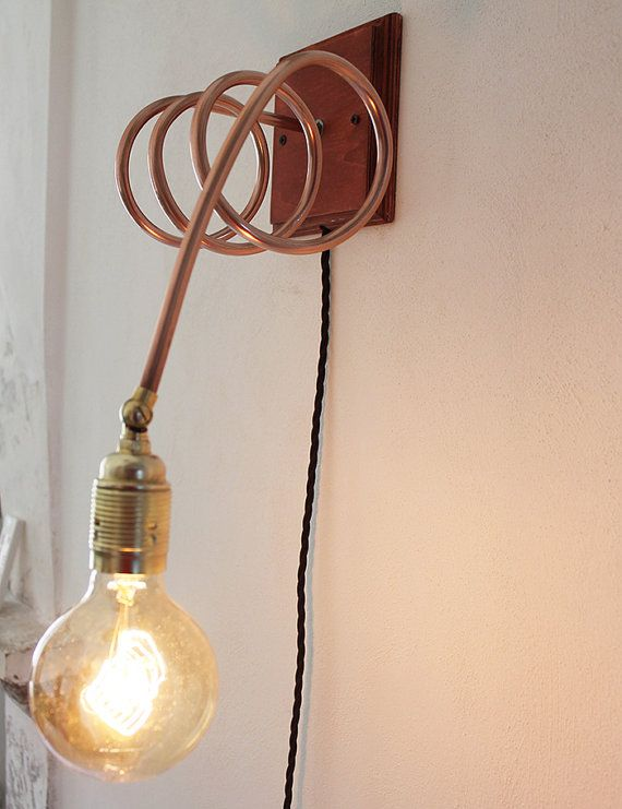 Wall hanging lamp in wood and copper with brass lampholder