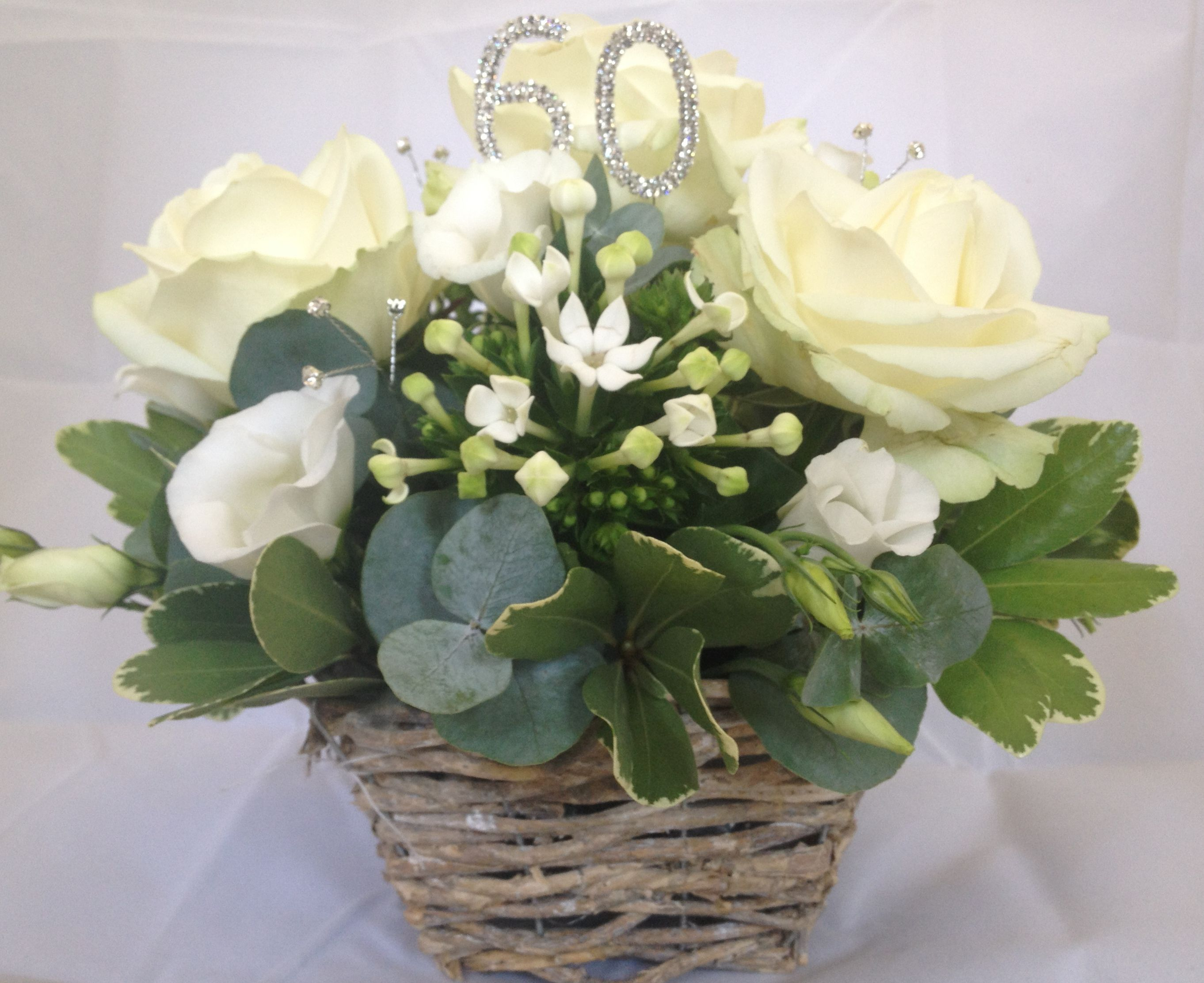 Flower arrangement in oasis for 60th diamond wedding anniversary by