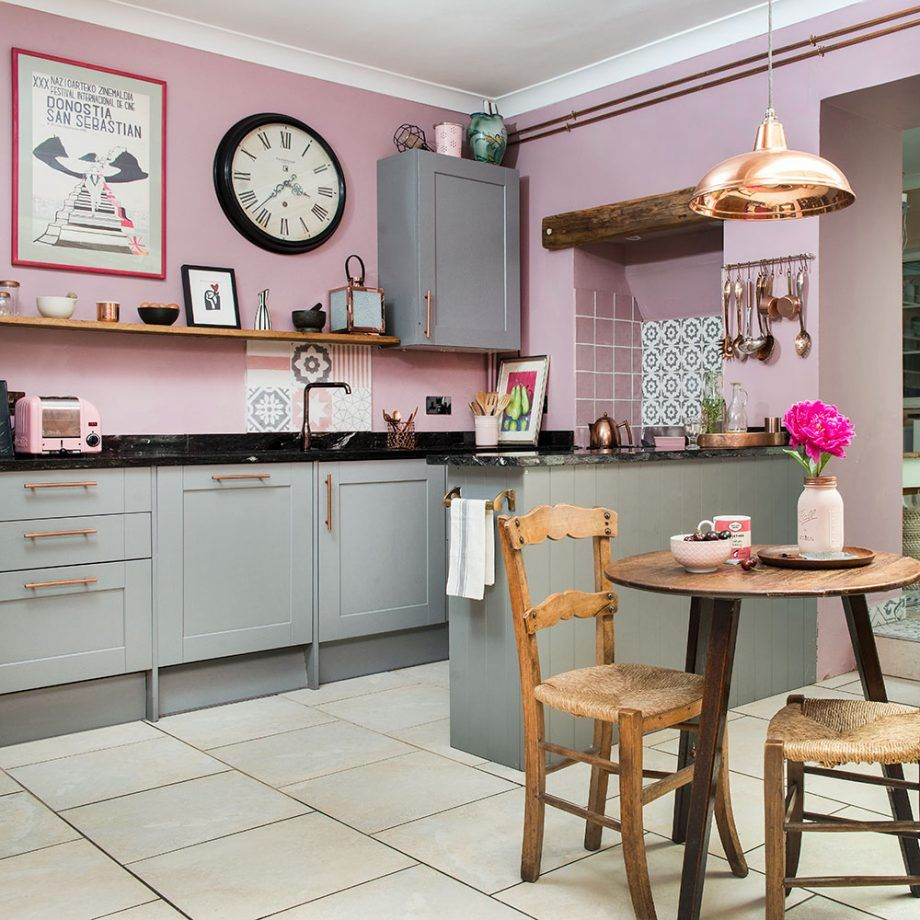 Kitchen makeover with pink walls, grey units and vintage furniture