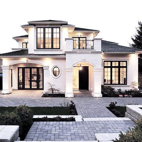 Stunning home exterior. White stucco Mediterranean / French style with  upstairs