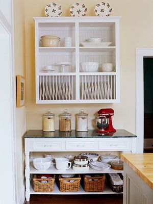 This refurbished table blends old and new with fresh white paint and a granite top. Two added shelves create optimal storage potential. #storage #diy #kitchen