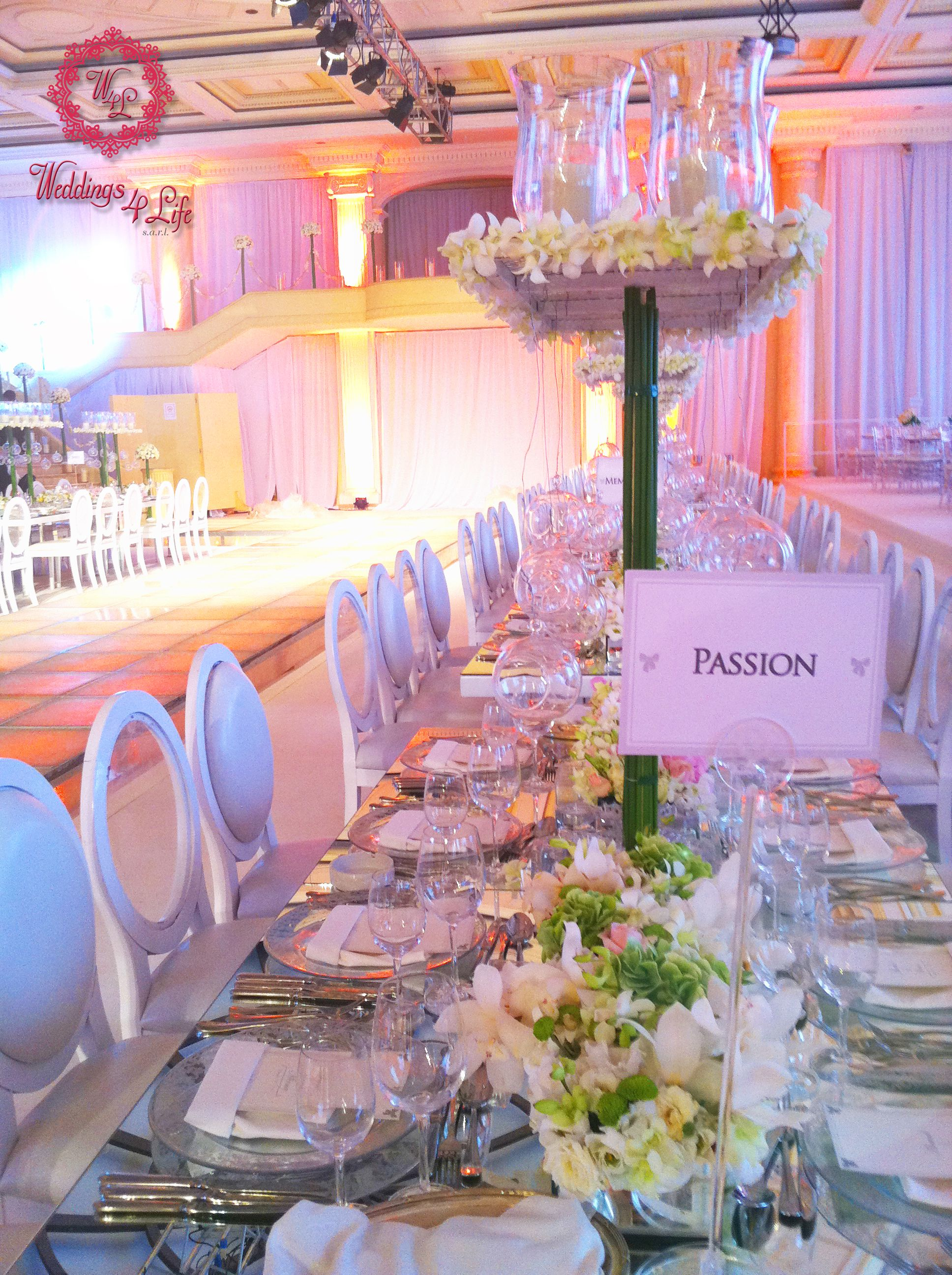 Dreamy white wedding setup High centerpiece with candle vases and ...