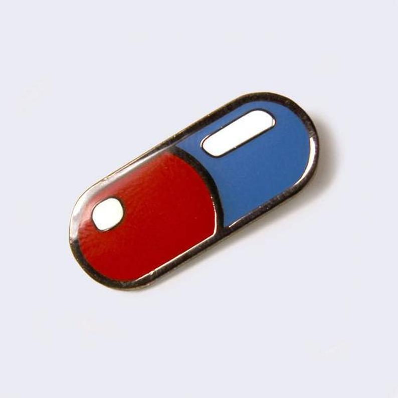 Red And Blue Pill Enamel Pin Glow In The Dark Etsy Red And Blue Red Pill Blue Pill Blue Aesthetic