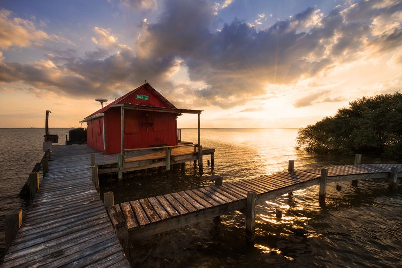 Red Shack Pine Island Sound Florida An Old Fish House On Stilts At Sunset In