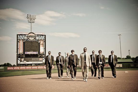 Mismatched groomsmen entering the wedding ceremony - aka on a baseball diamond!
