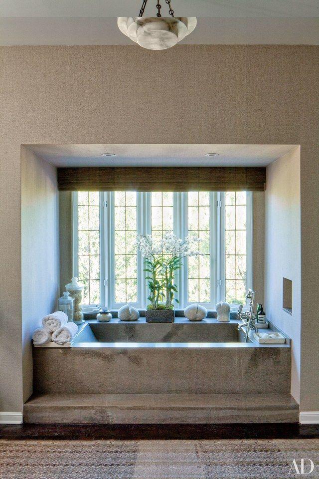bathtub in windowed alcove