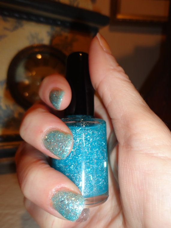 Frost nail polish is super glittery and sooo sooo pretty. Mixed with a light and bright shade of blue and a sprinkle of shredded silver tinsel. Paris Sparkles nail polish stands alone. If you want to add a clear top coat for maximum shine, no problem but never necessary. Shown with two coats of polish, no top coat.