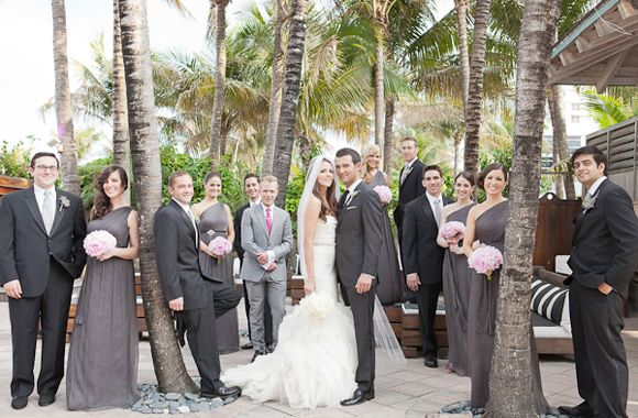 wedding party in black and grey with a pop of color in the flowers