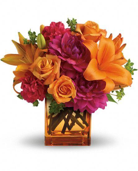 Decorations Hot Pink And Orange Floral Arrangements On Tables