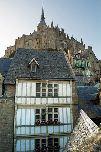 Mont Saint Michel - France - (from the 8th century onward) The structural composition of the town exemplifies the feudal society that constructed it. On top God, the abbey and monastery, below this the Great halls, then stores and housing, and at the bottom, outside the walls, fishermen and farmers housing.