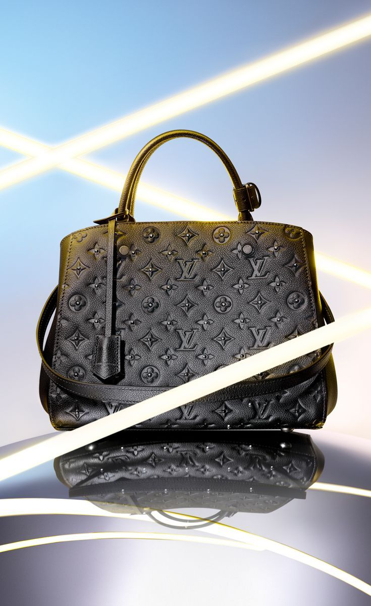 0a558e43e81c Add some rock n roll edge to your holidays with the Louis Vuitton embossed  leather Montaigne MM Monogram handbag. The metallic black and silver  details are ...