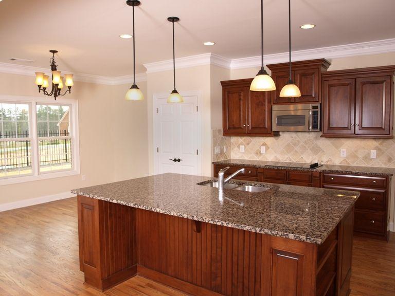 White flower granite on island in kitchen. | Granite Kitchen Tops ...